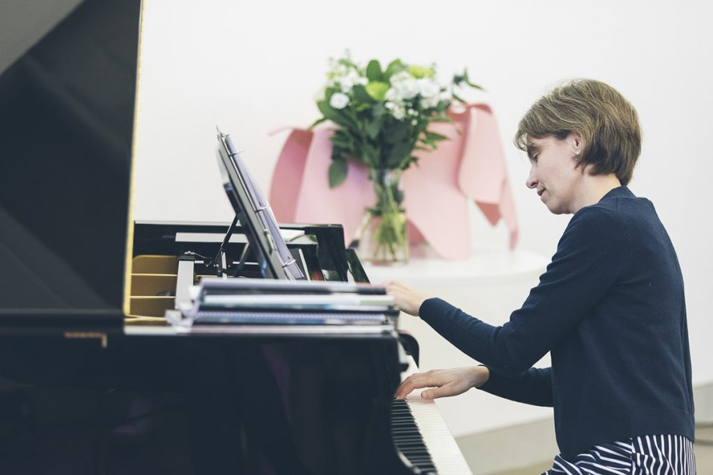 Dr. Julie Knerr playing piano at Piano Safari workshop in Belfast